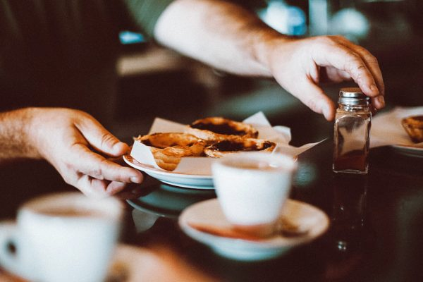 selective-focus-photography-of-man-holding-bowl-of-pastry-1546590
